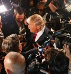Trump-Surrounded-By-Cameras-570x333